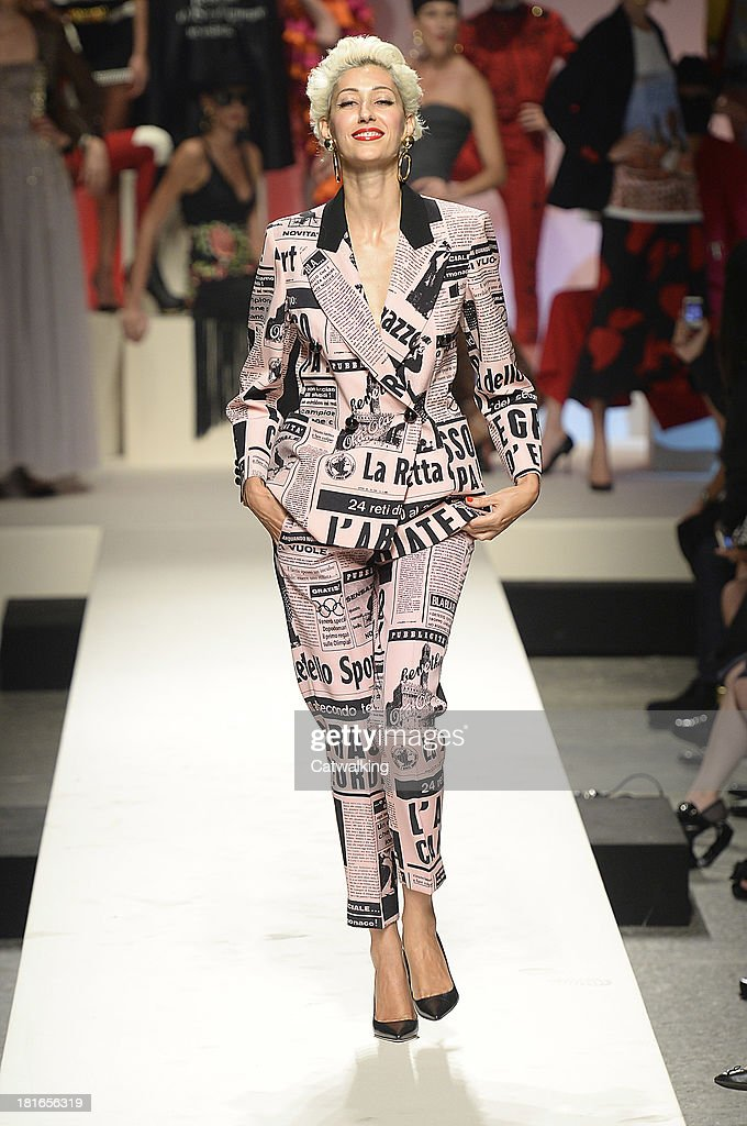 Supermodel Gisele Zelany walks the runway at the Moschino Spring Spring Summer 2014 fashion show during Milan Fashion Week on September 21, 2013 in Milan, Italy.