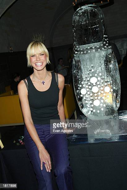Supermodel Heidi Klum poses with a Birkenstock shoe ice sculpture during the launch party for her selfdesigned Birkenstock shoe collection at Bryant...
