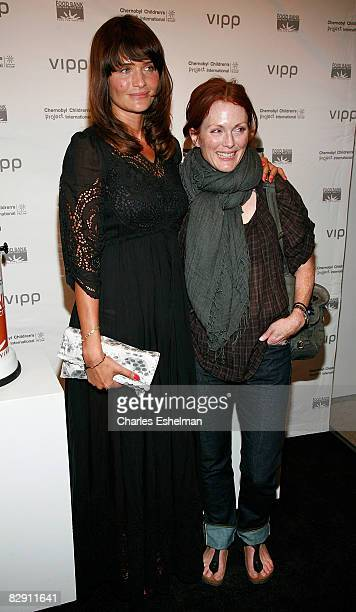 Supermodel Helena Christensen and actress Julianne Moore arrive at the Helena Christensen VIPP auction at Winston Wachter Fine Art Gallery on...