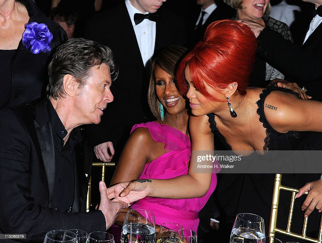 Supermodel <a gi-track='captionPersonalityLinkClicked' href=/galleries/search?phrase=Iman+-+Fashion+Model&family=editorial&specificpeople=132463 ng-click='$event.stopPropagation()'>Iman</a> (center) introduces her husband <a gi-track='captionPersonalityLinkClicked' href=/galleries/search?phrase=David+Bowie&family=editorial&specificpeople=171314 ng-click='$event.stopPropagation()'>David Bowie</a> (L) to <a gi-track='captionPersonalityLinkClicked' href=/galleries/search?phrase=Rihanna&family=editorial&specificpeople=453439 ng-click='$event.stopPropagation()'>Rihanna</a> (R) at the DKMS' 5th Annual Gala: Linked Against Leukemia honoring <a gi-track='captionPersonalityLinkClicked' href=/galleries/search?phrase=Rihanna&family=editorial&specificpeople=453439 ng-click='$event.stopPropagation()'>Rihanna</a> & Michael Clinton hosted by Katharina Harf at Cipriani Wall Street on April 28, 2011 in New York City.