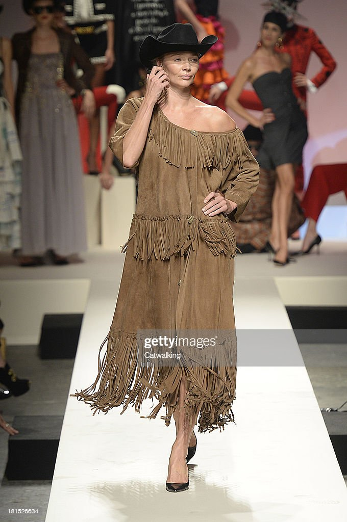 Supermodel <a gi-track='captionPersonalityLinkClicked' href=/galleries/search?phrase=Jodie+Kidd&family=editorial&specificpeople=178960 ng-click='$event.stopPropagation()'>Jodie Kidd</a> walks the runway at the Moschino anniversary event and Spring Summer 2014 fashion show during Milan Fashion Week on September 21, 2013 in Milan, Italy.