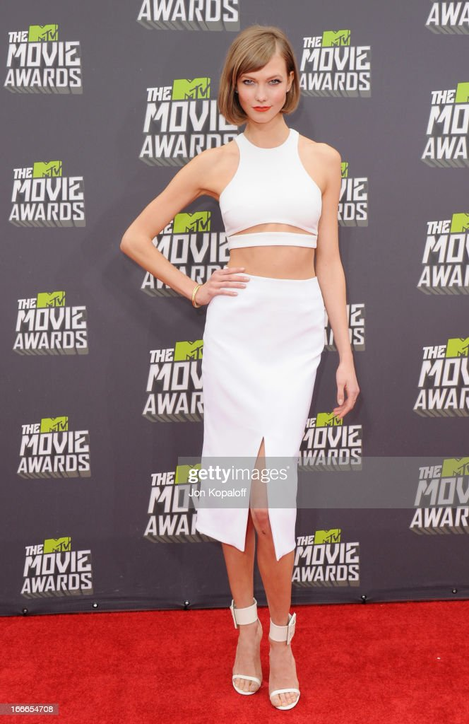 Supermodel Karlie Kloss arrives at the 2013 MTV Movie Awards at Sony Pictures Studios on April 14, 2013 in Culver City, California.