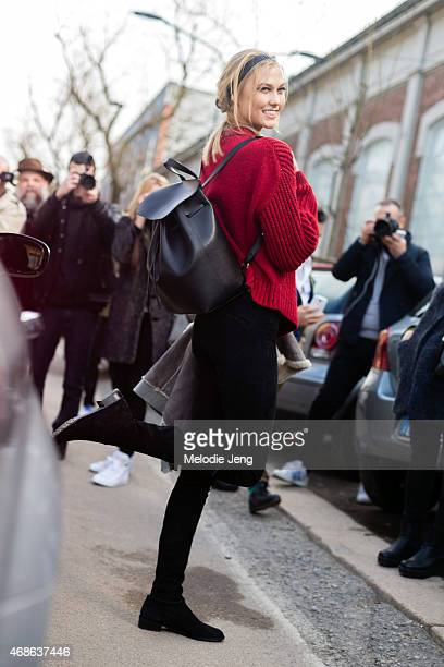Supermodel Karlie Kloss exits the Fendi show with a Mansur Gavriel backpack on Day 2 of Milan Fashion Week FW15 on February 26 2015 in Milan Italy
