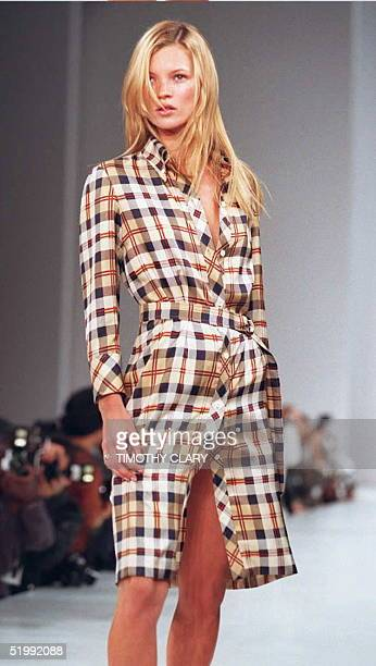 Supermodel Kate Moss wears a tartan silk/twill buttondown shirtdress during the Victor Alfaro 1996 Spring/Summer fashion show 30 October in New York...