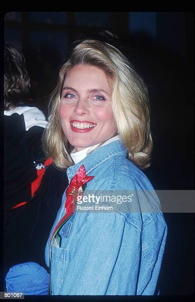 Supermodel Kim Alexis smiles at a Christmas parade December 25 1996 in Los Angeles CA Alexis whose face has graced the cover of over 500 magazines...