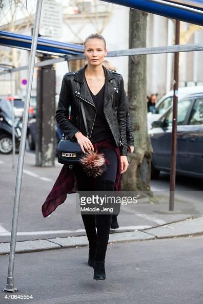 Supermodel Natasha Poly exits the Isabel Marant show at Palais de Tokyo in an Iro leather jacket Isabel Marant shirt Proenza Schouler bag and Fendi...