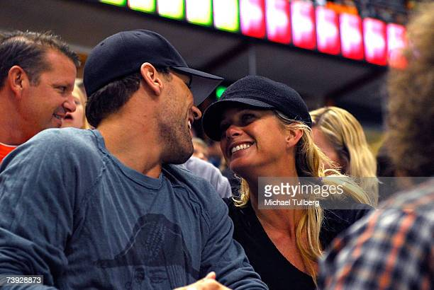 Supermodel Rachel Hunter and hockey player Jarret Stoll attend the final game of the Anaheim Ducks/Minnesota Wild hockey playoff series at the Honda...
