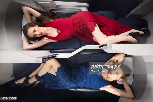 Supermodel sisters Georgia May Jagger and Lizzie Jagger pose for pictures wearing Alice Temperley dresses laying on a British Airways Club World...