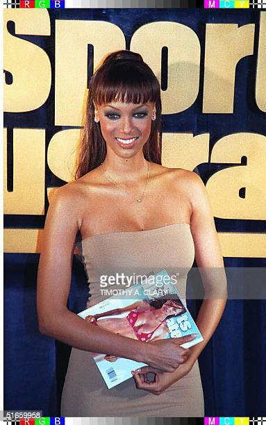 Supermodel Tyra Banks poses with a copy of Sports Illustrated during the 1997 Swimsuit Issue press conference 18 February in New York Banks is on the...
