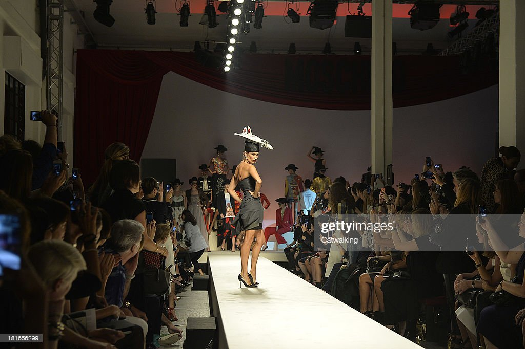 Supermodel Violetta Sanchez walk the runway at the Moschino Spring Spring Summer 2014 fashion show during Milan Fashion Week on September 21, 2013 in Milan, Italy.