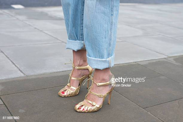 Supermodel Yasmin Le Bon wears Closed jeans and Manolo Blahnik shoes on day 3 during London Fashion Week Autumn/Winter 2016/17 on February 21 2016 in...