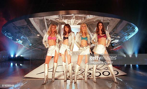 Supermodels Daniela Pestova Stephanie Seymour Karen Mulder and Ines Rivero pose in front of a spaceship to celebrate the launch of Victoria's Secret...
