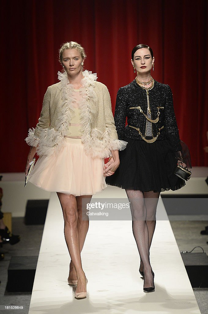 Supermodels Jodie Kidd (L) and Erin O'Connor (R) walk the runway at the Moschino anniversary event and Spring Summer 2014 fashion show during Milan Fashion Week on September 21, 2013 in Milan, Italy.