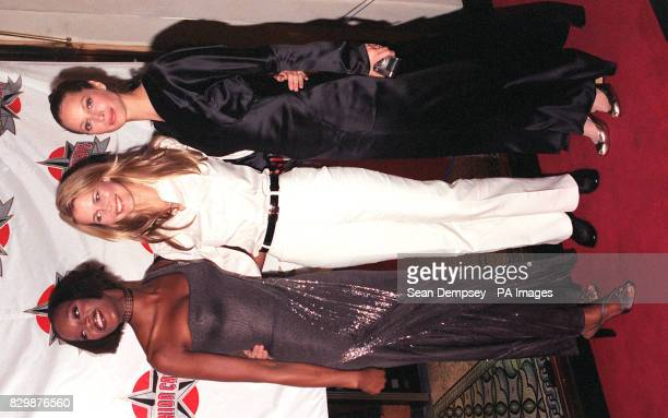 Supermodels Naomi Campbell Claudia Schiffer and Christy Turlington pose for photographers this evening on their arrival for the opening party of the...