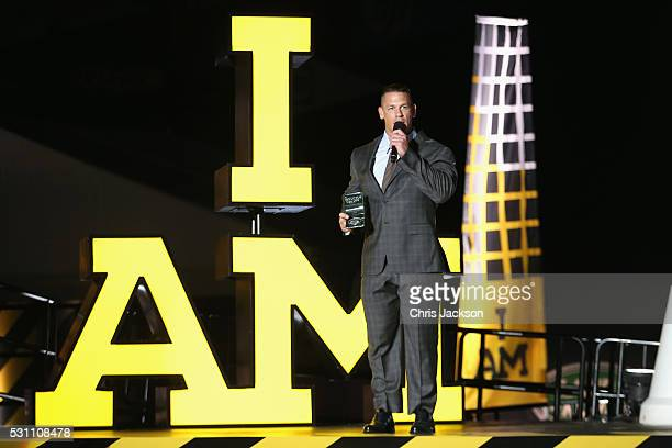 WWE superstar and actor John Cena presents The Land Rover Above Beyond Award onstage at the Invictus Games Orlando 2016 Closing Ceremony at ESPN Wide...