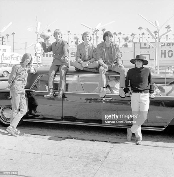 Superstar group 'Buffalo Springfield' pose for a portrait sitting on a car in 1966 in Los Angeles California Bruce Palmer Dewey Martin Stephen Stills...