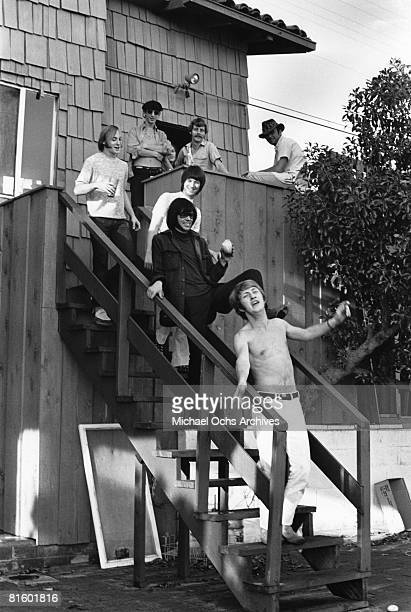 Superstar group 'Buffalo Springfield' pose for a portrait with two unidentified men on the steps of their house on October 30 1967 in Malibu...