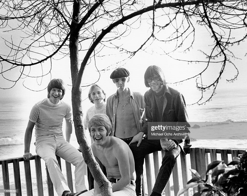 Superstar group 'Buffalo Springfield' poses for a portrait on a deck overlooking the ocean on October 30, 1967 in Malibu, California. (L-R) Richie Furay, Stephen Stills, Bruce Palmer, Neil Young, Dewey Martin (in front).