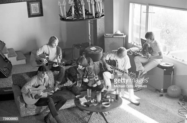 Superstar group 'Buffalo Springfield' rehearse inside their house on October 30 1967 in Malibu California Bruce Palmer Stephen Stills Neil Young...