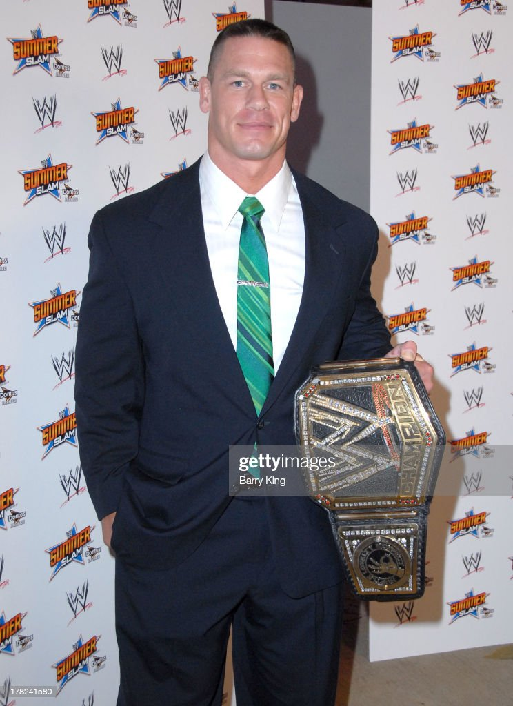 Superstar <a gi-track='captionPersonalityLinkClicked' href=/galleries/search?phrase=John+Cena&family=editorial&specificpeople=644116 ng-click='$event.stopPropagation()'>John Cena</a> attends the WWE SummerSlam Press Conference on August 13, 2013 at the Beverly Hills Hotel in Beverly Hills, California.