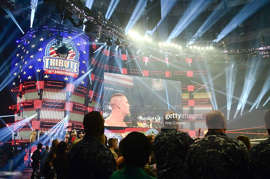 WWE Superstar <a gi-track='captionPersonalityLinkClicked' href=/galleries/search?phrase=John+Cena&family=editorial&specificpeople=644116 ng-click='$event.stopPropagation()'>John Cena</a> performs during the 10th anniversary of WWE Tribute to the Troops at Norfolk Scope Arena on December 9, 2012 in Norfolk, Virginia.