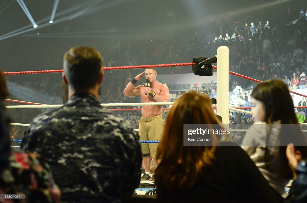 WWE Superstar John Cena performs during the 10th anniversary of WWE Tribute to the Troops at Norfolk Scope Arena on December 9, 2012 in Norfolk, Virginia.