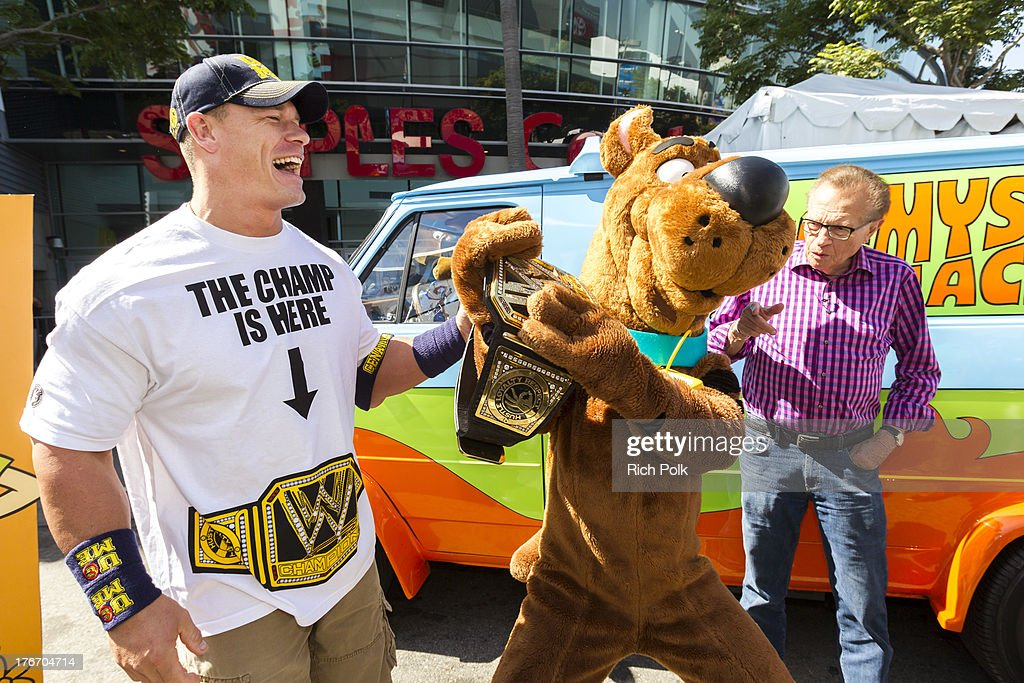 Superstar <a gi-track='captionPersonalityLinkClicked' href=/galleries/search?phrase=John+Cena&family=editorial&specificpeople=644116 ng-click='$event.stopPropagation()'>John Cena</a> runs into Scooby and <a gi-track='captionPersonalityLinkClicked' href=/galleries/search?phrase=Larry+King&family=editorial&specificpeople=202014 ng-click='$event.stopPropagation()'>Larry King</a> backstage at Summerslam's Fan Axxess. The two will reunite this spring in WWE Studios & Warner Bros. Scooby-Doo! WrestleMania Mystery at Summer Slam 2013.' on August 17, 2013 in Los Angeles, California.