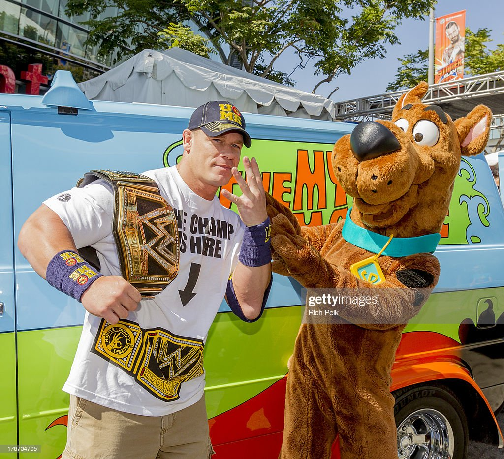 Superstar <a gi-track='captionPersonalityLinkClicked' href=/galleries/search?phrase=John+Cena&family=editorial&specificpeople=644116 ng-click='$event.stopPropagation()'>John Cena</a> runs into Scooby backstage at Summerslam's Fan Axxess. The two will reunite this spring in WWE Studios & Warner Bros. Scooby-Doo! WrestleMania Mystery at Summer Slam 2013.' on August 17, 2013 in Los Angeles, California.