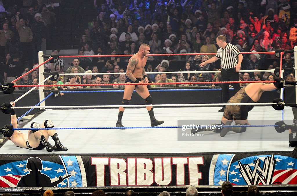 WWE Superstar <a gi-track='captionPersonalityLinkClicked' href=/galleries/search?phrase=Randy+Orton&family=editorial&specificpeople=3073398 ng-click='$event.stopPropagation()'>Randy Orton</a> and WWE Superstar Big Show perform during the 10th anniversary of WWE Tribute to the Troops at Norfolk Scope Arena on December 9, 2012 in Norfolk, Virginia.