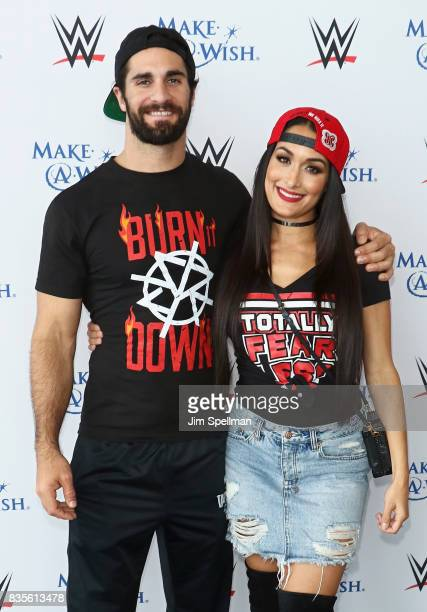 Superstar Seth Rollins and Nikki Bella attend the WWE Superstars Surprise MakeAWish Families at One World Observatory on August 19 2017 in New York...