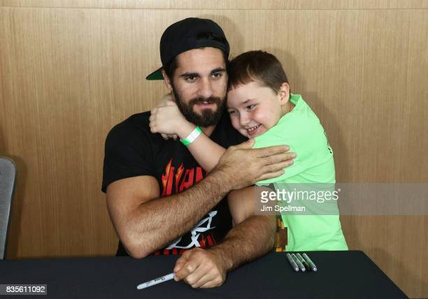 Superstar Seth Rollins poses with a wish kid at the WWE Superstars Surprise MakeAWish Families at One World Observatory on August 19 2017 in New York...