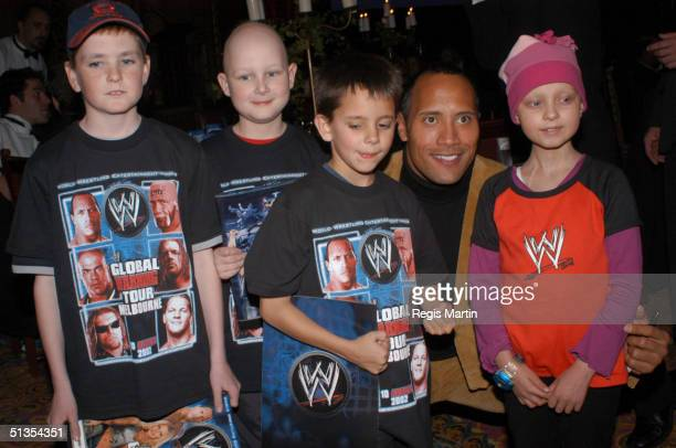 Superstar The Rock with some children from CHALLENGE at the Plaza Ballroom in Melbourne for the charity gala dinner for CHALLENGE at Melbourne...