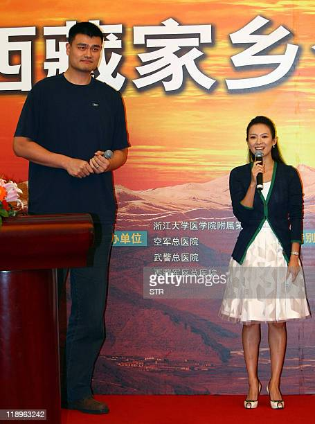 NBA superstar Yao Ming makes an appearance with movie star Zhang Ziyi in a charity event to raise money for a medical aid to Tibet in Beijing on July...
