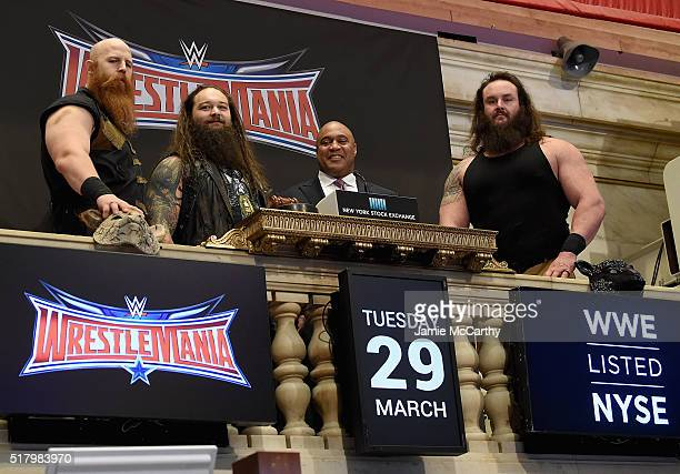Superstars Erick Rowan Bray Wyatt and Braun Strowman with NYSE Global head of capital markets Garvis Toler ring The New York Stock Exchange Opening...