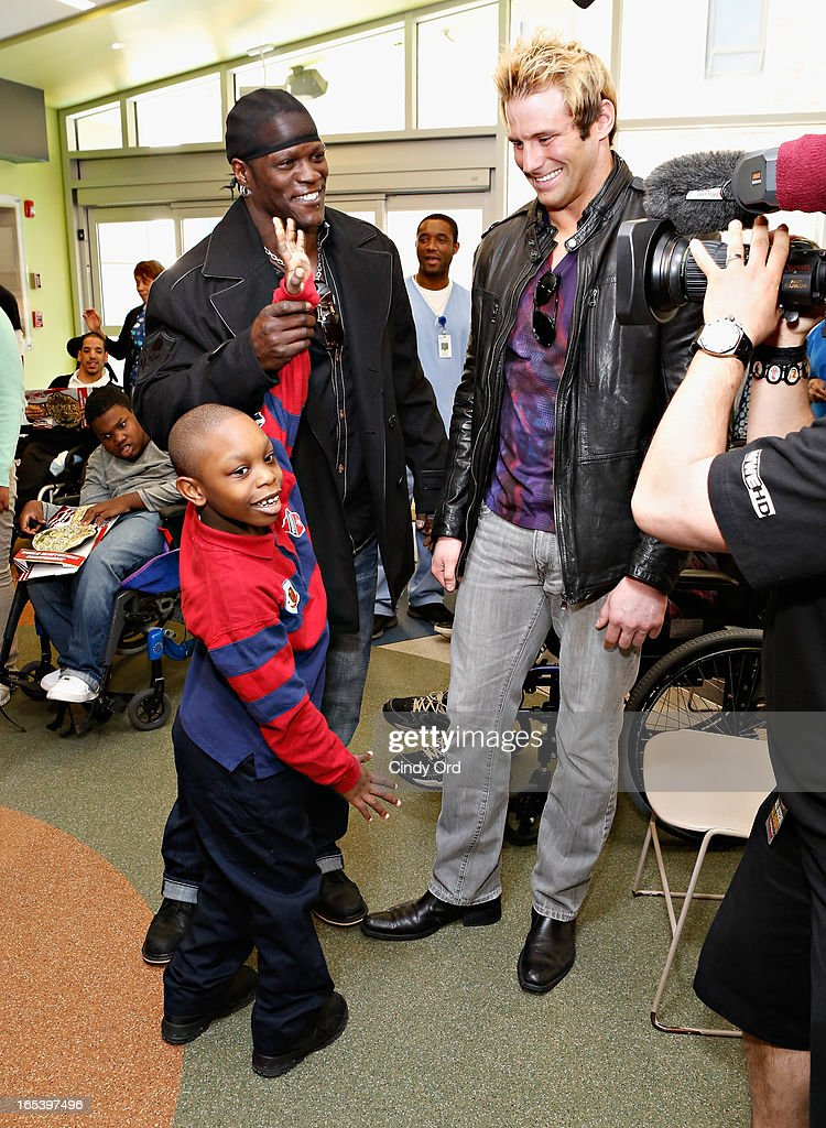 WWE Superstars R-Truth and Zack Ryder visit with patients at St. Mary's Hospital For Children on April 3, 2013 in New York City.