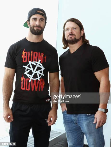 Superstars Seth Rollins and AJ Styles attend the WWE Superstars Surprise MakeAWish Families at One World Observatory on August 19 2017 in New York...