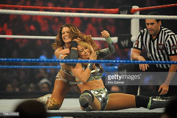 Superstars WWE Dive Eve Torres and WWE Diva Layla wrestle during 10th anniversary of WWE Tribute to the Troops at Norfolk Scope Arena on December 9...