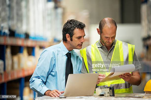 Supervisor and worker discussing at warehouse