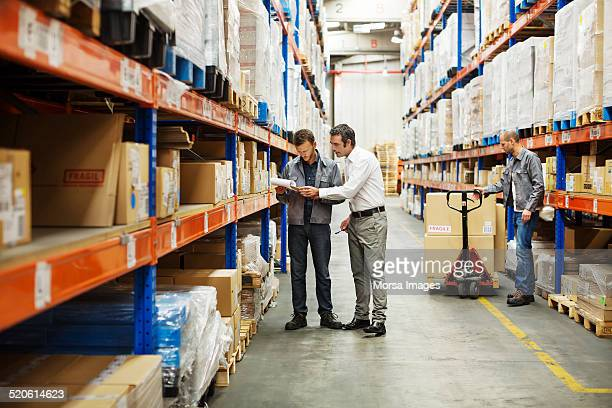 Supervisor discussing with worker at warehouse