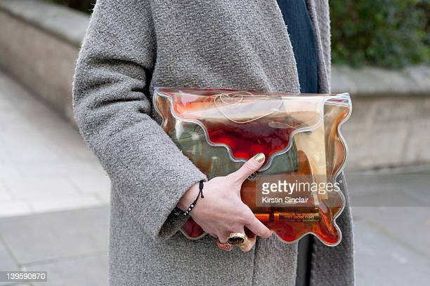 Supervisor Helen Robson wearing Christopher Kane bag Topshop Boutique jacket and dress YSL rings street style at London fashion week autumn/winter...