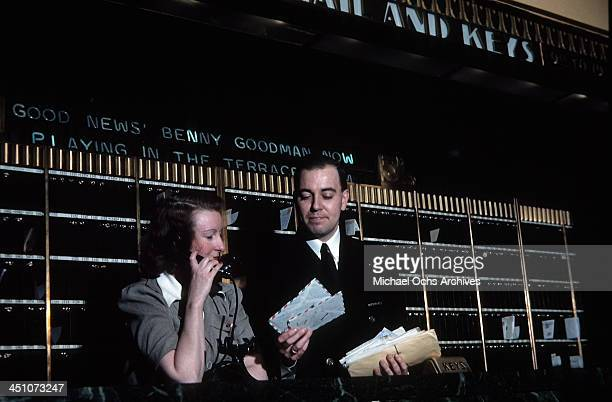 A supervisor sorts mail at the front desk in The Plaza Hotel in New York New York