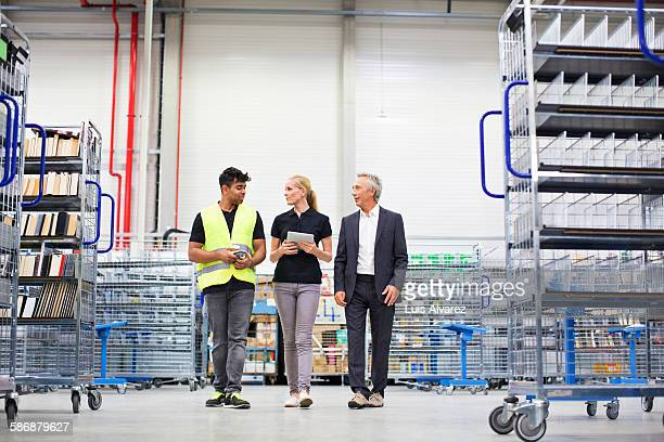 Supervisors communicating in logistics center