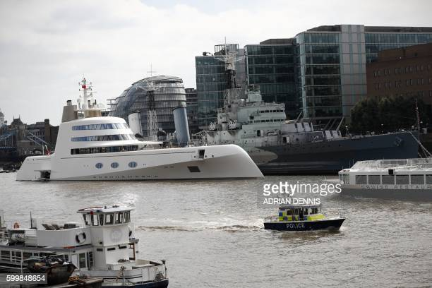 A superyacht Motor Yacht A owned by Russian billionaire Andrey Melnichenko is moored against HMS Belfast on the river Thames in London September 7...