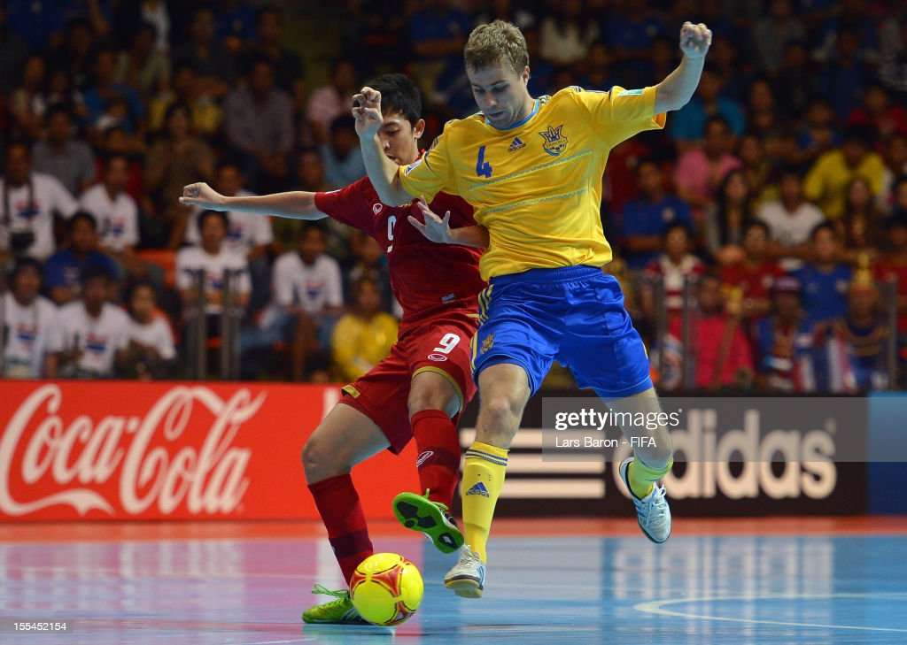 Suphawut Thuenklang of Thailand challenges Sergiy Zhurba of Ukraine during the FIFA Futsal World Cup Group A match between Thailand and Ukraine at Indoor Stadium Huamark on November 4, 2012 in Bangkok, Thailand.