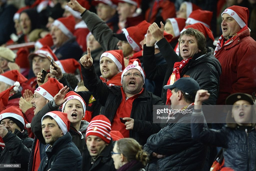 supoorters of Standard show their colours during the Jupiler League match between Standard Liege and RSC Anderlecht on December 22, 2013 in Liege, Belgium.