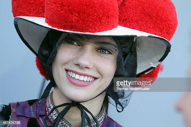 A suporter of Freiburg wearing a traditional 'Bollenhut' is seen prior to the Bundesliga match between SC Freiburg and VfL Wolfsburg at MAGE SOLAR...
