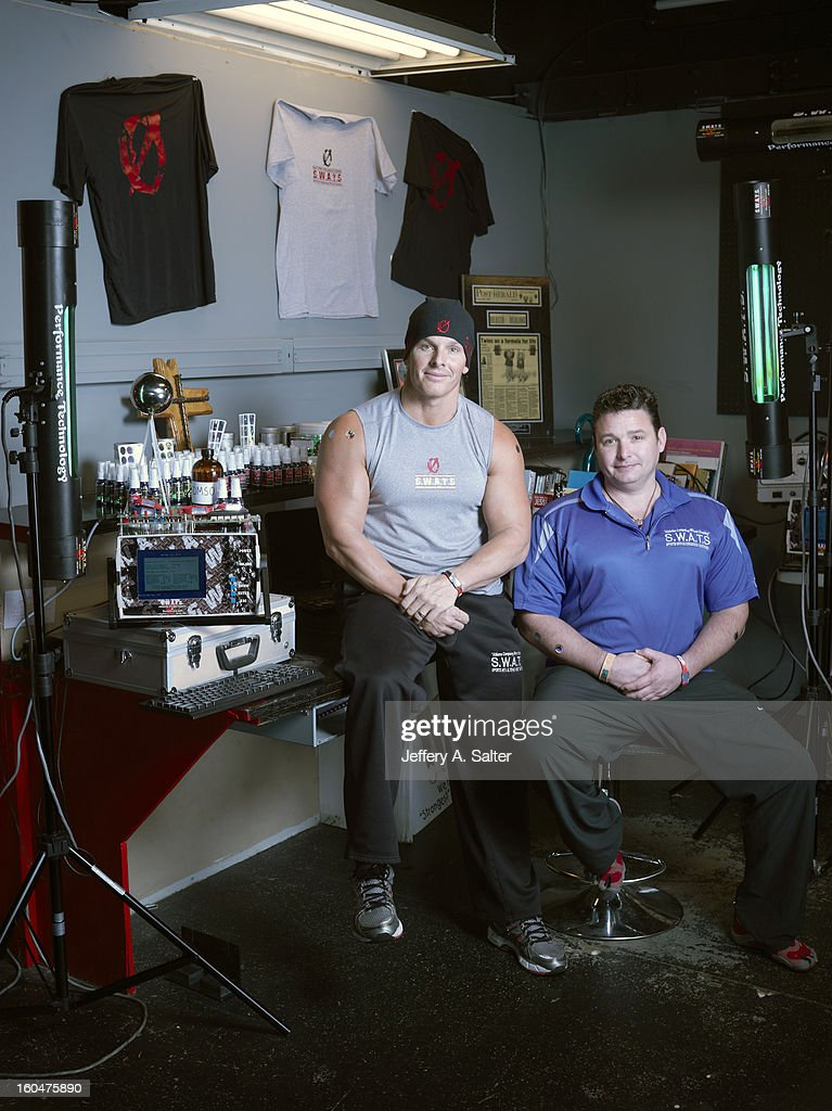 Portrait of Mitch Ross (L) and Chris Key during photo shoot at their S.W.A.T.S. Health & Fitness Center. Their company, Sports with Alternatives to Steroids, sells holographic stickers, deer antler velvet, and negatively charged water. Athletes have been linked to using these products, some of which contain IGF-1 which is banned by collegiate and professional sports. Jeffery A. Salter X156057 TK1 R1 F13 )
