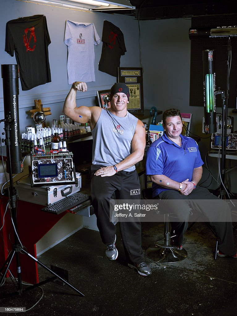 Portrait of Mitch Ross (L) and Chris Key during photo shoot at their S.W.A.T.S. Health & Fitness Center. Their company, Sports with Alternatives to Steroids, sells holographic stickers, deer antler velvet, and negatively charged water. Athletes have been linked to using these products, some of which contain IGF-1 which is banned by collegiate and professional sports. Jeffery A. Salter X156057 TK1 R1 F17 )