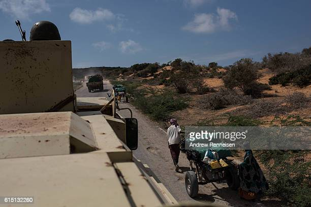 A supply convoy comprised of the 17th Battle Group of the Uganda People's Defense Force serving in the African Union Mission in Somalia moves past...