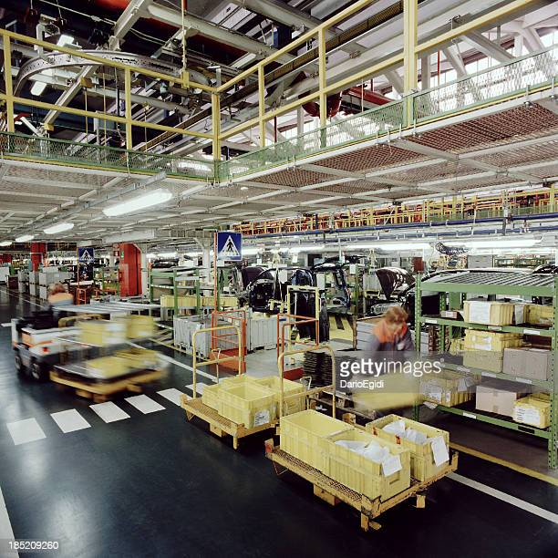 Supply line and workers in an automotiv industry